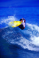 Surfer surfing on the south shore of Maui
