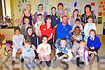 PET TIME: Lisa Thorton and Damien Moran (seated centre) from Petmania who visited the kids of Brookview After School, Sunday Wells, Lisloose Tralee with a snake, spider, rabbits and other pets on Tuesday.