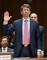 """Mark W. Begor, Chief Executive Officer, Equifax, Inc. is sworn-in to testify before the United States Senate Committee on Homeland Security and Governmental Affairs Permanent Subcommittee on Investigations during a hearing on """"Examining Private Sector Data Breaches"""" on Capitol Hill in Washington, DC on Thursday, March 7, 2019.<br /> Credit: Ron Sachs / CNP/AdMedia"""