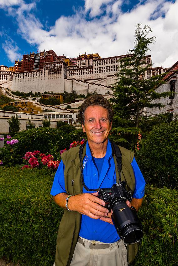 Photographer Blaine Harrington outside the Potala Palace, Lhasa, Tibet, China.