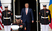 United States President Donald J. Trump emerges from the Diplomatic Entrance of the White House to welcome President Klaus Iohannis of Romania in Washington, DC on Tuesday, August 20, 2019.<br /> Credit: Ron Sachs / CNP