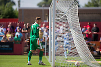 Russell Griffiths of Cheltenham looks dejected after conceding his side's first goal during the Sky Bet League 2 match between Cheltenham Town and Leyton Orient at the LCI Rail Stadium, Cheltenham, England on 6 August 2016. Photo by Mark  Hawkins / PRiME Media Images.