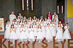 Holy Cross/Mercy NS pupils who received their Holy Communion in St Mary's Cathedral, Killarney on Saturday with back l-r: Monsignor Reidy, Lucy O'Mahony, Therese Counihan and Fr Horgan..