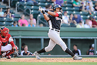 First baseman Ronald Guzman (22) of the Hickory Crawdads bats in a game against the Greenville Drive on Friday, June 7, 2013, at Fluor Field at the West End in Greenville, South Carolina. Guzman is the No. 17 prospect of the Texas Rangers, according to Baseball America. The catcher is the Drive's Jayson Hernandez. Greenville won the resumption of this May 22 suspended game, 17-8. (Tom Priddy/Four Seam Images)