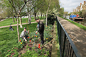 Gardener Joe Ambrosino and volunteer Eric Haynes working at Meanwhile Gardens, a community-run open space in North Kensington, London.