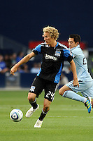 Steven Lenhart (24) San Jose Earthquakes shields the ball from Davy Arnaud Sporting KC...Sporting KC defeated San Jose Earthquakes 1-0 at LIVESTRONG Sporting Park, Kansas City ,Kansas,..