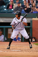 Jacksonville Suns outfielder Carlos Lopez (7) squares to bunt during a game against the Chattanooga Lookouts on April 30, 2015 at AT&T Field in Chattanooga, Tennessee.  Jacksonville defeated Chattanooga 6-4.  (Mike Janes/Four Seam Images)