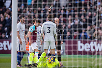 Referee Anthony Taylor shows Marcos Alonso of Chelsea a yellow card during the Premier League match between West Ham United and Chelsea at the Olympic Park, London, England on 9 December 2017. Photo by Andy Rowland.