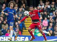 Troy Deeney of Watford David Luiz of Chelsea during the Premier League match between Chelsea and Watford at Stamford Bridge, London, England on 21 October 2017. Photo by Andy Rowland.