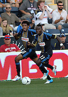 CHESTER, PA - AUGUST 12, 2012:  Sheanon Williams (25) and Freddy Adu (11) of the Philadelphia Union on the attack against the Chicago Fire during an MLS match at PPL Park, in Chester, PA on August 12. Fire won 3-1.