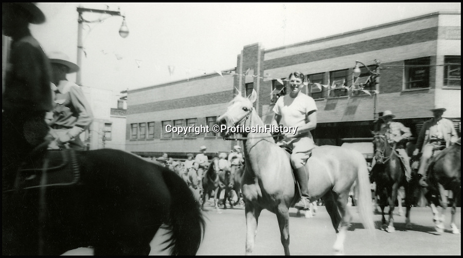 BNPS.co.uk (01202 558833)<br /> Pic: ProfilesInHistory/BNPS<br /> <br /> Reagan back in his home town of Dixon, Illinois in 1950 riding a Palomino horse in a parade.<br /> <br /> An intimate album capturing hundreds of candid pictures of Ronald Reagan has emerged at auction with a presidential £100,000 price tag.  <br /> <br /> The vast archive follows the Republican icon from his early days in Hollywood, start of his political career and through his time in the White House. <br /> <br /> Away from the state dinners, film shoots and grandstanding these pictures offer a glimpse into his most private moments as he laughs with his young family.