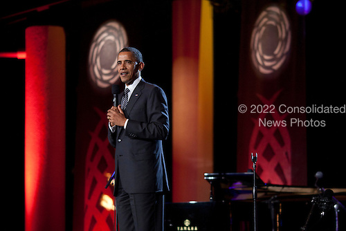 United States President Barack Obama delivers remarks before a Luau after the Asia-Pacific Economic Cooperation (APEC) summit dinner at the Hale Koa Hotel in Honolulu, Hawaii on Saturday, November 12, 2011..Credit: Kent Nishimura / Pool via CNP
