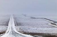 Trans Alaska Oil Pipeline parallels the James Dalton highway in winter.