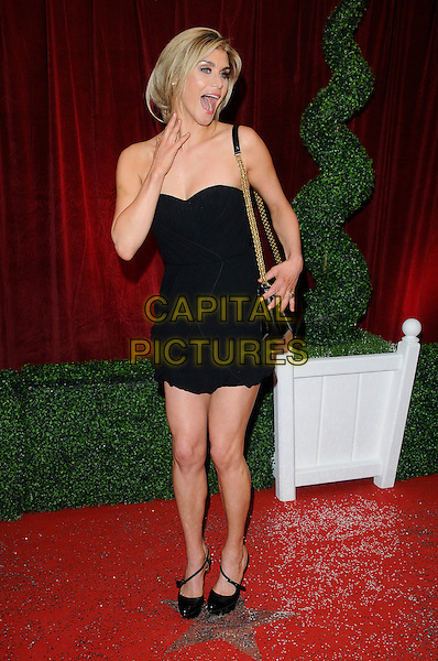 Kim Tiddy.Attending the British Soap Awards 2012.at the London Television Centre, London, England, UK, 28th April 2012..arrivals  full length strapless black dress bag chain strap shoes hand mouth open funny .CAP/CAN.©Can Nguyen/Capital Pictures.