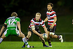 Baden Kerr needs to get the pass away ahead of Hadleigh Parkes tackle. ITM Cup rugby game between Counties Manukau and Manawatu played at Bayer Growers Stadium on Saturday August 21st 2010..Counties Manukau won 35 - 14 after leading 14 - 7 at halftime.