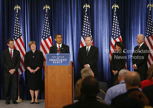 Chicago, IL - November 24, 2008 -- United States President-elect Barak Obama (C) introduces his economic team with Vice President-elect Joe Biden (R) during a news conference on Monday, November 24, 2008 in Chicago. Obama named Treasury Secretary-designate Timothy Geithner, (from left) Council of Economic Advisers Chair-designate Christina Romer, National Economic Council Director-designate Lawrence Summers and White House Domestic Policy Council Director-designate Melody Barnes. .Credit: Brian Kersey - Pool via CNP