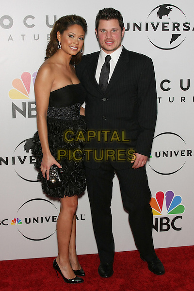 VANESSA MINNILLO & NICK LACHEY .The 2010 NBC, Universal Pictures & Focus Features' Annual Golden Globes After-Party at the Beverly Hilton, Beverly Hills, CA, USA.                                                                         January 17th, 2010.globes full length black suit strapless dress clutch bag couple layers layered frills .CAP/LNC/AM.©Alba Montes/LNC/Capital Pictures