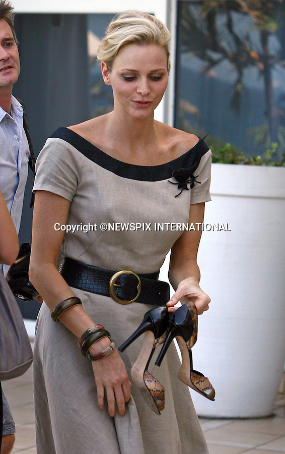 """.EXCLUSIVE!!  """"Must Telephone +441279 324672 For Repro Fees and Usage - Special Fees Apply""""..CHARLENE WITTSTOCK_puts shoes on..Beverly Hills Hotel in Umhlanga, KwaZulu-Natal, South Africa .The soon to be Princess of Monaco was in South Africa to compete .in the Midmar Mile is the world's largest open water swim event, South Africa and visit other projects_14/02/2011.Mandatory Credit Photos: ©Newspix International..**ALL FEES PAYABLE TO: """"NEWSPIX INTERNATIONAL""""**..PHOTO CREDIT MANDATORY!!: NEWSPIX INTERNATIONAL(Failure to credit will incur a surcharge of 100% of reproduction fees)..IMMEDIATE CONFIRMATION OF USAGE REQUIRED:.Newspix International, 31 Chinnery Hill, Bishop's Stortford, ENGLAND CM23 3PS.Tel:+441279 324672  ; Fax: +441279656877.Mobile:  0777568 1153.e-mail: info@newspixinternational.co.uk"""