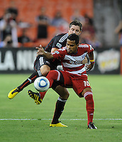 FC Dallas forward David Ferreira (10) shields the ball against DC United defender Devon McTavish (18).  FC. Dallas defeated DC United 3-1 at RFK Stadium, Saturday August 14, 2010