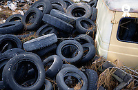 Car Wreck and Pile of used car tires, Portugal (Licence this image exclusively with Getty: http://www.gettyimages.com/detail/81867409 )