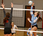 SIOUX FALLS, SD - SEPTEMBER 16: Abbie Jarratt #6 from Lincoln attempts a kill past Emily VanBockern #16 from Washington in the second game of their match Tuesday night at Lincoln.  (Photo by Dave Eggen/Inertia)