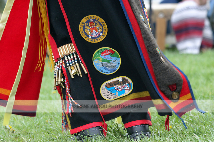 A Native American at the Healing Horse Spirit PowWow in Mt. Airy, Maryland sports U.S. military badges sewn onto his traditional regalia.