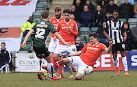 Jonathan Smith gets stuck into a challenge during the Sky Bet League 2 match between Plymouth Argyle and Luton Town at Home Park, Plymouth, England on 19 March 2016. Photo by Liam Smith.