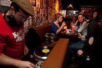 A DJ plays records at Soda cocktail bar, Lyon, France, 13 January 2012