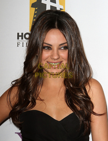 MILA KUNIS.14th Annual Hollywood Awards Gala Presented By Starz held at The Beverly Hilton Hotel, Beverly Hills, CA, USA..October 25th, 2010.headshot portrait black strapless smokey eyes make-up beauty.CAP/ADM/KB.©Kevan Brooks/AdMedia/Capital Pictures.