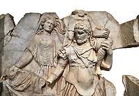 Close up of a RomanSebasteion relief  sculpture of Aineas&rsquo; flight from Troy, Aphrodisias Museum, Aphrodisias, Turkey.   Against a white background.<br /> <br /> Aineas in armour carries his aged farther Anchises on his shoulders and leads his young son Lulus by his hand. They are fleeing from the sack of Troy. The figure floating behind is Aphrodite, Aineas&rsquo; mother: she is helping their escape. Old Anchises carries a round box that held images of Troy&rsquo;s ancestral gods.
