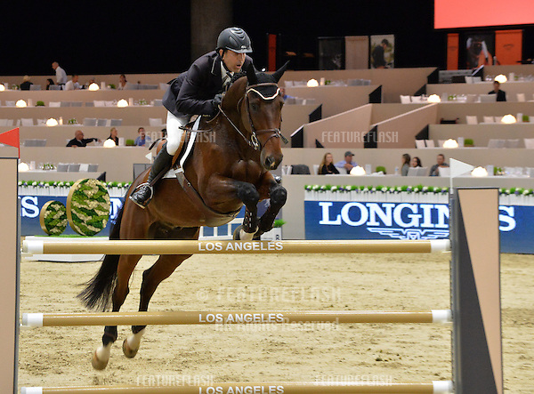 Marc Grock (USA) riding Caretol in the Artemide Trophy International jumping competition at the 2015 Longins Masters Los Angeles at the L.A. Convention Centre.<br /> October 1, 2015  Los Angeles, CA<br /> Picture: Paul Smith / Featureflash