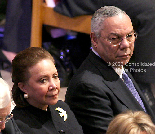 Former United States Secretary of State Colin Powell, right, and his wife, Alma, left, attend the State Funeral for former United States President Gerald R. Ford at the Washington National Cathedral, in Washington, D.C. on Tuesday, January 2, 2007..Credit: Ron Sachs / CNP.[NOTE: No New York Metro or other Newspapers within a 75 mile radius of New York City].