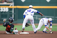 Florida Gators shortstop Richie Martin (12) and second baseman Dalton Guthrie (5) scramble for the baseball as Miami Hurricanes baserunner Christopher Barr (17) slides into second base during the NCAA College World Series on June 13, 2015 at TD Ameritrade Park in Omaha, Nebraska. Florida defeated Miami 15-3. (Andrew Woolley/Four Seam Images)