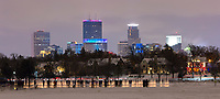 Minneapolis skyline with illuminated ice luminaries at the 2018 Luminary Loppet on Lake of the Isles in Minneapolis, Minnesota