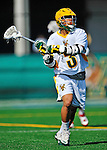 17 March 2012: University of Vermont Catamount Midfielder Ahmad Zachary, a Sophomore from Lower Merion, PA, in action against the Sacred Heart University Pioneers at Virtue Field in Burlington, Vermont. The Catamounts defeated the visiting Pioneers 12-11 with only 10 seconds remaining in their non-conference matchup. Mandatory Credit: Ed Wolfstein Photo