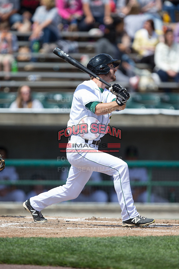 Mike Papi (38) of the Lynchburg Hillcats follows through on his swing against the Frederick Keys at Calvin Falwell Field at Lynchburg City Stadium on May 14, 2015 in Lynchburg, Virginia.  The Hillcats defeated the Keys 6-3.  (Brian Westerholt/Four Seam Images)