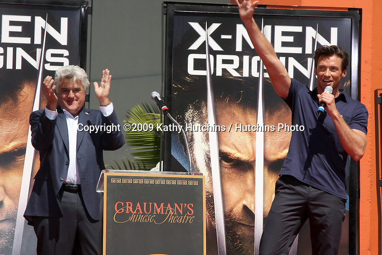 Jay Leno & Hugh Jackman  at the Hugh Jackman Handprint & Footprint Ceremony at Grauman's Chinese Theater Forecourt in Los Angeles,  California on April 21, 2009.©2009 Kathy Hutchins / Hutchins Photo....                .