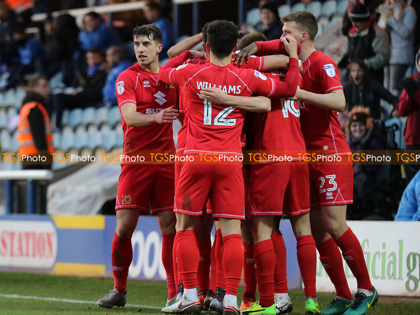 MK Dons players congratulate Kieran Agard after scoring their second goal during Peterborough United vs MK Dons, Sky Bet EFL League 1 Football at London Road on 28th January 2017