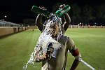 Steven Echevarria (15) of the Wake Forest Demon Deacons is doused with water by teammate Ema Twumasi (22) as he conducts a post game interview following his game winning goal in double overtime against the Clemson Tigers at Spry Soccer Stadium on September 29, 2017 in Winston-Salem, North Carolina.  The Demon Deacons defeated the Tigers 3-2 in 2OT.  (Brian Westerholt/Sports On Film)