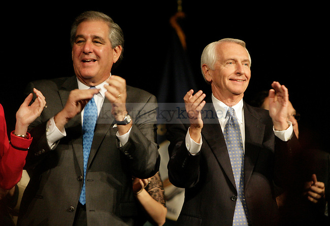 Democratic governor and Lt. Governor candidates Steve Beshear (right) and Jerry Abramson (left) celebrate their victory in the Frankfort Convention Center Tuesday night, Nov. 8, 2011. Photo by Scott Hannigan | Staff