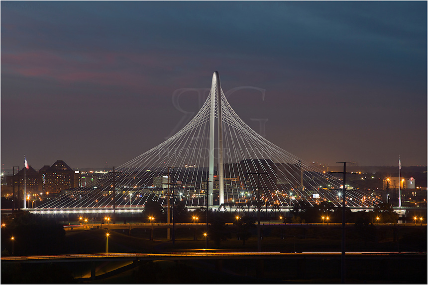 The Margaret Hunt Hill Bridge has become a fixture in Dallas skyline images after its completion in 2012. The bridge is one of three bridges being constructed as part of the Trinity River Project. The Dallas bridge connects Woodall Rodgers to Singleton Boulevard in west Dallas. The project cost 93 million dollars to complete.