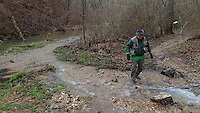 NWA Democrat-Gazette/FLIP PUTTHOFF<br /> Joe Neal steps across a creek Dec. 30, 2015 at the park. Waterproof shoes are handy for exploring the falls area after a heavy rain.