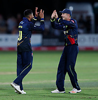 Imran Qayyum (L) of kent is congratulated by Joe Denly after taking the wicket of Keaton Jennings during the T20 Quarter-Final game between Kent Spitfires and Lancashire Lightning at the St Lawrence ground, Canterbury, on Aug 23, 2018.