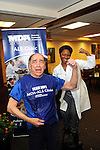 Dr. Stanley Appel and  Dr. Ericka Simpson flex after an Ice Bucket Challenge at the Muscular Dystrophy Association ALS Clinic at the Houston Methodist Neurology Institute Monday Aug. 18, 2014.(Dave Rossman photo)