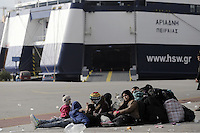 Pictured: Migrants at the port Friday 26 February 2016<br /> Re: Hundreds of refugees that crossed the border from Turkey to the Greek islands, have arrived at the port of Piraeus near Athens, Greece