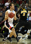 Gonzaga's Kevin Pangos (4) looks to pass the ball against Iowa during the 2015 NCAA Division I Men's Basketball Championship's March 22, 2015 at the Key Arena in Seattle, Washington. #2 Gonzaga beat #7 Iowa 87-68 to advance to the Sweet 16. ©2015. Jim Bryant Photo. ALL RIGHTS RESERVED.