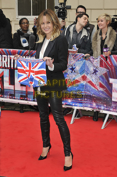 Amanda Holden.The Britain's Got Talent 2013 press launch, ICA, Carlton House, The Mall, London, England..April 11th 2013..full length black suit blazer jacket white top leather trousers pants tuxedo holding union jack boxer shorts boxers pants underpants underwear .CAP/DS.©Dudley Smith/Capital Pictures