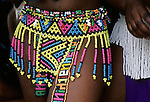 NONGOMA, SOUTH AFRICA - SEPTEMBER 11: An unidentified maiden shows her traditional Zulu skirt made of beads, as she's preparing for the annual Reed Dance on September 11, 2004 in Nongoma in rural Natal, South Africa. About 20.000 fellow maidens from all over South Africa has arrived to dance for Zulu King Goodwill Zwelethini at the Enyokeni Royal Palace in Kwa-Nongoma about 350 kilometers from Durban. The girls come to the kingdom to declare their virginity and the ceremony encourages girls and young women to abstain from sexual activity to curb the spread of HIV-Aids..(Photo: Per-Anders Pettersson)....