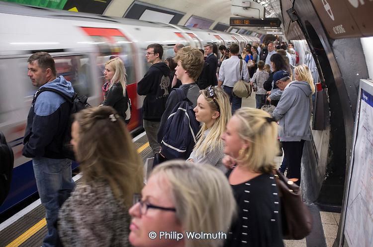 Crowded platform at Charing Cross tube station at rush hour London.