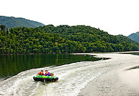 Visitors to Watauga Lake, Tennessee, enjoy a day of tubing along the pristine lake. Lake Watauga, located between Boone, NC, and Elizabethton, TN, is surrounded by Cherokee National Forest and is largely undeveloped.
